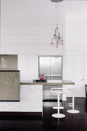 A subtle palette of textures was used to  anchor the kitchen space gently within the living spaces.
