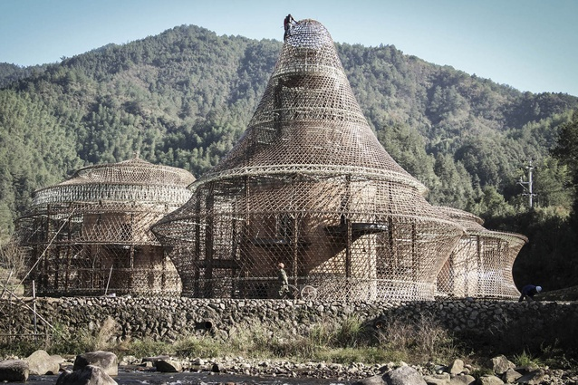 Bamboo Hostels, China. The round buildings feature a open bamboo structure, woven like a basket around a solid core of rammed earth and stone.