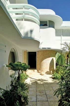 The art deco mansion features many curves and circles as part of its charm.