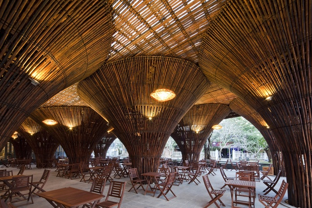 Kontum Indochine café. The 15 inverse cone-shaped columns are inspired by traditional Vietnamese fishing baskets and create the sensation of dining in a bamboo forest.