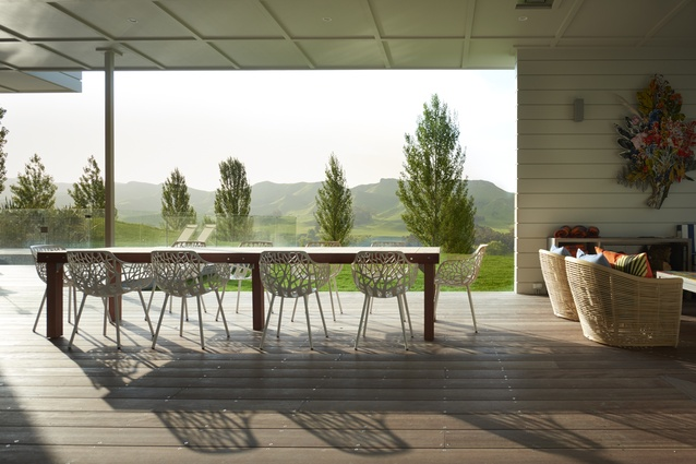 A table on the pool deck made in Andy Coltart's workshop from purpleheart timber. Designer Brigit Christie matched the substantial piece with Fast Forest armchairs bought locally.