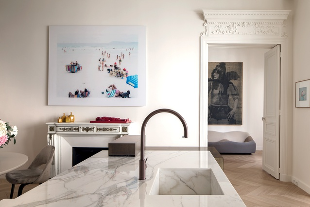 Marble and brass kitchen made to measure by Parente. Massimo Vitali painting above the fireplace; ABCD sofa by Pierre Paulin, and a picture in the second room by David Noonan.
