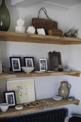 """""""Portraits of Ed's and my family. Seaweed from the beach in Sussex, alongside a kete from New Zealand, stones from places we go, a crystal from my godchild."""""""