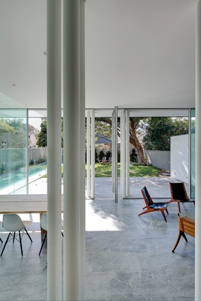The already-wide house is expanded further by large glazed openings to the northern corner, with views to the pool.