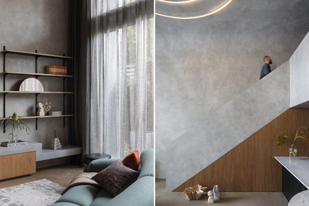A full-height glass window ensures the apartment receives plenty of natural light; a wall treatment that gives the appearance of concrete was used in response to the designer's core principle of sustainability.