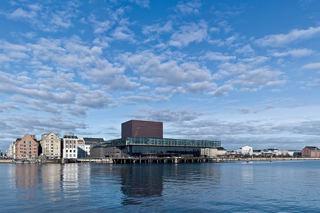 The Royal Danish Theatre Playhouse is located at the edge of Copenhagen. Its oak board promenade sits above the quayside and accesses the large public foyer of the theatre.