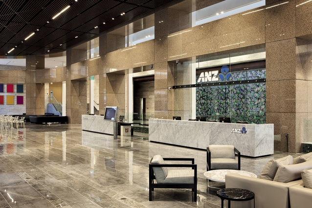 The ANZ reception, with Florida limestone reception desk. The existing cladding of the building, which was retained, is a reddish-pink stone called Rosso Porrino.