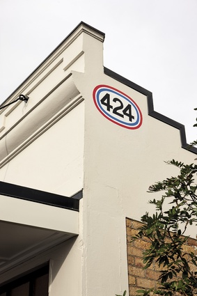 Hand-painted signage referencing the building's original purpose.