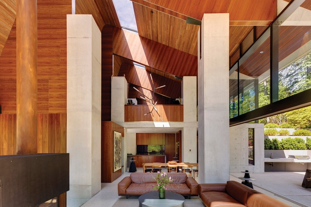 """A skylight in the high ceiling cuts the house in two along its longitudinal length, """"axing the space surprisingly and splitting a volume like a log."""""""