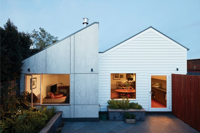 """The raw-finish cement sheet cladding on the new volume was chosen for its """"honesty"""" and the contrast it provides to the weatherboard of the original home."""