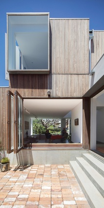 Large windows frame selected views and open the house up to breezes and the outdoors.