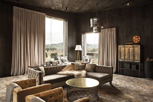 Warm metallic tones illuminate the interior spaces in the main lodge building of Kinloch Golf Club.