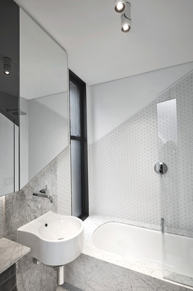 The textured palette of materials is limited to black, white and grey throughout the home.