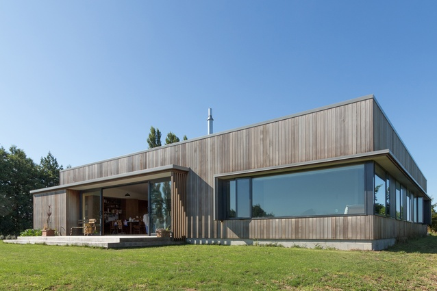 Maniatutu Road residence. The home is situated on an elevated promontory with distant coastal views toward Motiti Island and Mount Maunganui.