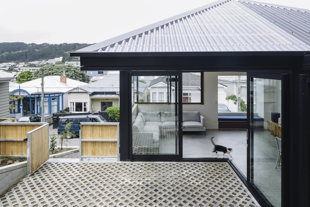 Connected by a central sheltered courtyard, Pyramid Scheme has floor-to-ceiling sliding doors on the ground level that thread together the kitchen, living and courtyard.