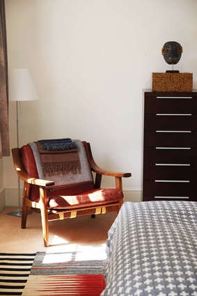 Hetariki's apartment includes two mid-century modern armchairs by Hans Wagner, with original burnt-orange leather upholstery.
