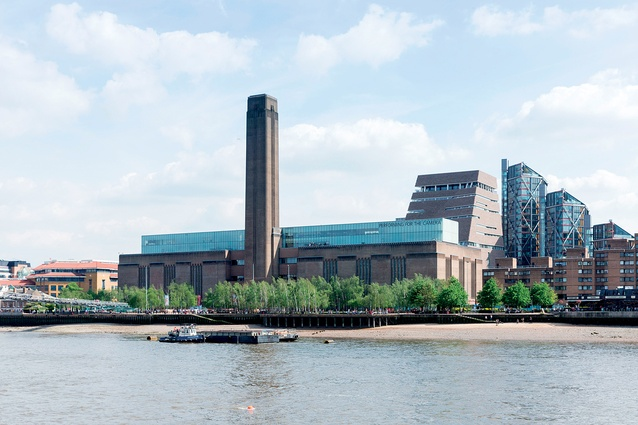 The new Switch House extension rises up behind the Tate Modern, which was originally designed as a power station in the 1950s.