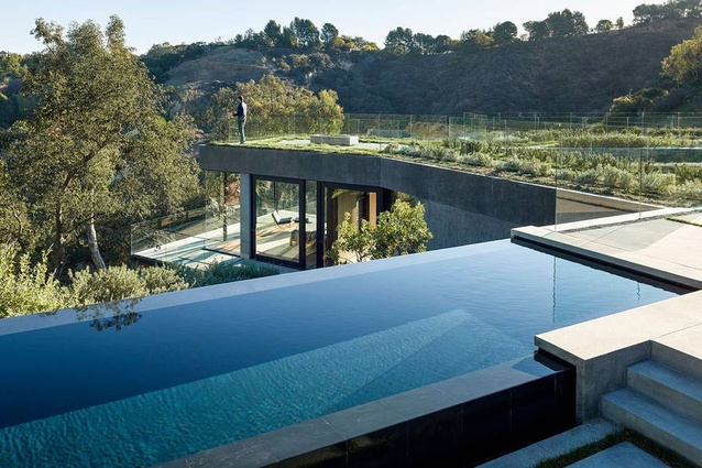 The master bedroom is seen beyond the pool.