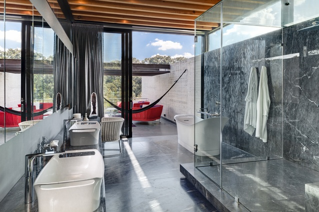 Bathrooms showcase some of the home's luxurious, imported fittings and furnishings, including the basinet-shaped porcelain bath and basins.