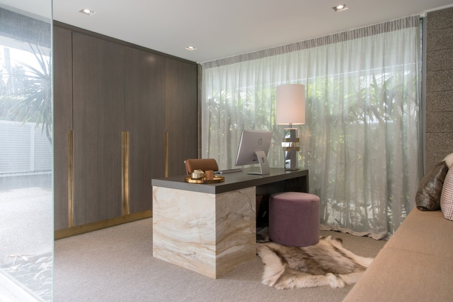 The office features more of a 'sexy' feel to the design, with the use of opulent materials such as Italian marble, brass-accented timber veneer doors, reindeer hide and cashmere.