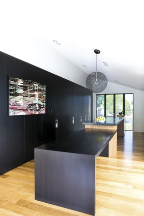 The kitchen cabinets conceal the working parts of the kitchen and the master bedroom and en suite.