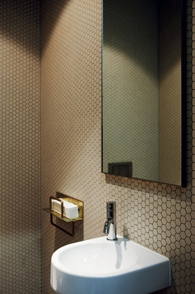 Bathrooms are tastefully restrained in colour palette.