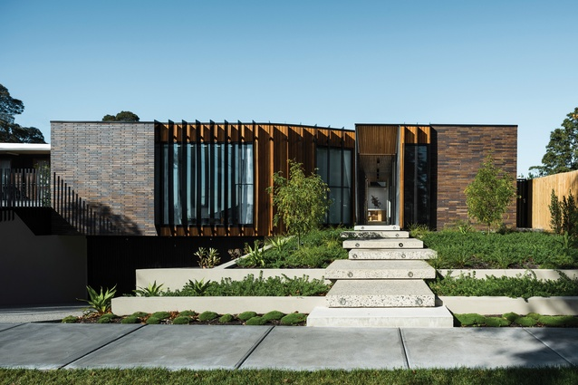 The street elevation of the Courtyard House takes subtle cues from neighbouring properties, particularly in the use of the elongated brown brick.