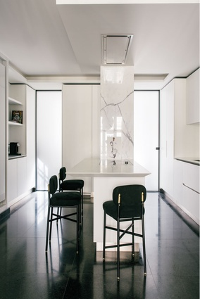 A black and white colour palette and high gloss joinery gives the kitchen a super slick aesthetic.