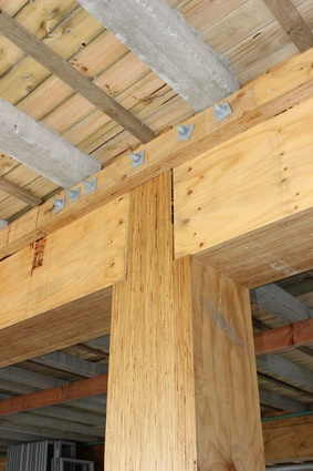 Rebated columns seat floor beams, enabling a simple bolted corbel to hold the floor, beams and posts in location.