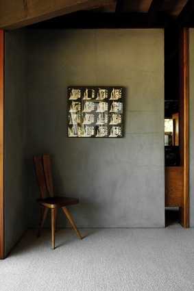 A Carlo Mollino Oak Side Chair designed for the Casa del Sole Apartments sits in the corner of this space.