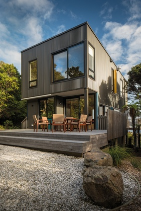 Corrugated cladding is injected with pops of colour in the window fins.